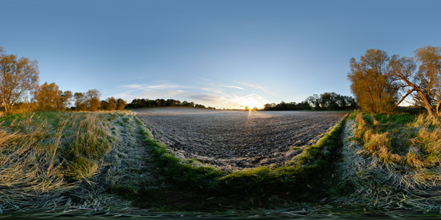 Frosty field at sunrise 360° Panorama