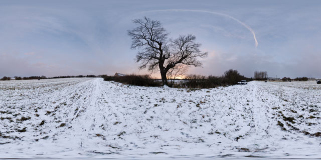 Snowy field at twilight 360° Panorama